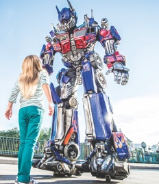 A girl looks up at Optimus Prime at Universal Studios Florida.